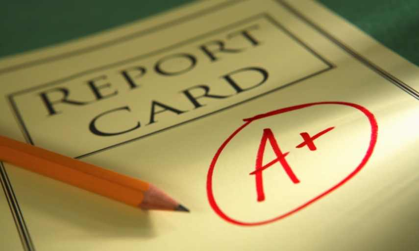 """A reporting card signed """"A plus"""""""