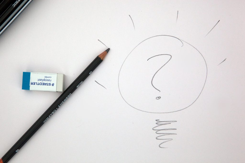a pencil and an eraser on a white paper