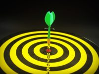 a dartboard with an arrow in the center